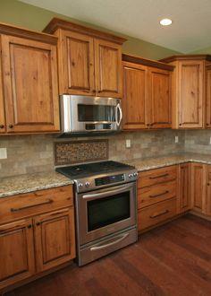 Kraftmaid cabinets at lowes monument house pinterest for Kraftmaid microwave shelf