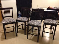 Reupholstered chairs in zebra print.