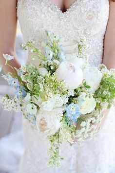 White Festiva Max Peonies, Lt Blue Delphiniums, White Mondial Roses, White Spirea branches, and Queen Anne's Lace bouquet by Spring Sweet