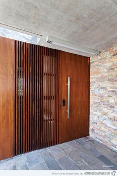 This wooden door jive with the stoned walls and floors that show its smooth and rough texture.