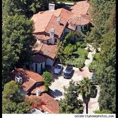 Ryan Seacrest bought this hacienda from Kevin Costner for $11.5 million. 5 bedrooms and 10,000 square feet, plus media room, billiards room, staff quarters, gym, pool, spa.  What, no botox room?