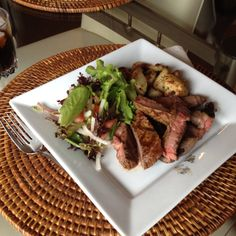 Filet of beef with roasted potatoes and a mixed green salad with a simple white wine vinaigrette.