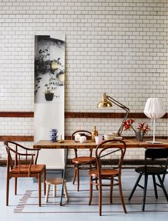 Industrial style kitchen with old wooden chairs