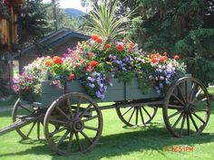 A unique set of the most wonderful images of flower garden wagon posted by team on October 2017 at pm Container Flowers, Flower Planters, Flower Pots, Most Beautiful Flowers, Beautiful Gardens, Pretty Flowers, Rustic Gardens, Outdoor Gardens, Wagon Planter