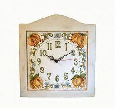 Wall clock. Wall clock made of wood and ceramic.