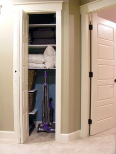 So smart to have room for your vacuum but then not waste the other space and have some shelves.