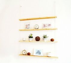 s 19 clever shelving ideas that aren t actually shelves, repurposing upcycling, shelving ideas, Tie wood planks together with rope and hang