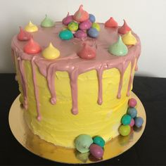 Chocolate raspberry cake yellow buttercream pink white chocolate drizzle chocolate mini eggs and meringue kisses