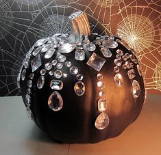 To create this look, invite your child to coat the outside of the pumpkin with black acrylic paint using a ...