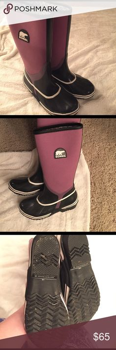 """Sorel """"Sorellington"""" rain boots Great waterproof  canvas and rubber women's Sorel  tall rain boots. Black and purple. Women's size 7.  Like new condition. They are too small for me now!! Sorel Shoes Winter & Rain Boots"""