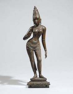 PARVATI - South India, Vijayanagar Period, circa 1400 Superbly, solidly and expressively cast standing in elegantly swayed tribhanga on a round lotus base over a square plinth, wearing a long dhoti falling in undulating folds secured with a sash. Buddha Sculpture, Bronze Sculpture, Sculpture Art, Indian Gods, Indian Art, Asian Sculptures, Hindu Statues, Southeast Asian Arts, Hindu Deities