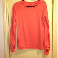 I just discovered this while shopping on Poshmark: Oiselle Orange Long sleeve…