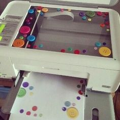 Lay buttons or other decorative objects on your scanner or photo copier to make decorative writing paper DIY pretty fancy note paper