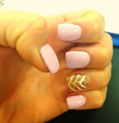 Acrylic with shellac light pink and accent gold nail with chevron design.