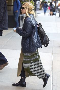 Who: Mary-Kate Olsen What: A Quilted Leather Jacket Why: The fashion mogul was cozy chic in a knit skirt, flat booties and a quilted leather jacket. Get the look now: Barney's New York jacket, $2,195,barneys.com.