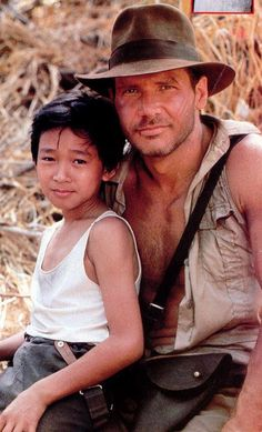 Ke Huy Quan and Harrison Ford on set of Temple Of Doom in 1983.