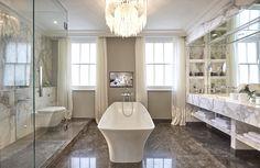 The master bathroom at Wilton Street, freestanding bath, huge walk-in shower and statement chandelier decorated by Laura Hammett