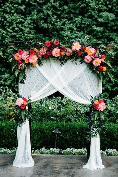 peony and greenery floral wedding arch