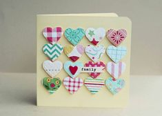 "handmade Mother's Day card ... ""Heart of the family"" ... get out your paper scraps and punch lots of hearts ... arrange them in a pattern with all touching ... pop them up for extra dimension if the card won't be mailed ... put a special extra heart on one of punched hearts near the middle ... attach label ... great thoughtful  design ..."