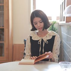 I love this cute Korean blouse! The model is wearing it under a black pinafore dress in this photo, but if you click through you can see it without the dress. I just really love the collar, it's like flower petals! :D