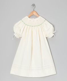 Reminiscent of days gone by, this frock keeps the tradition of smocking alive by stylishly outfitting darlings to create memories today. Back buttons ensure easy-peasy changing of this breezy bishop dress.