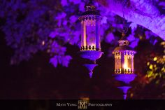 Purple lighting for an outdoor wedding reception.