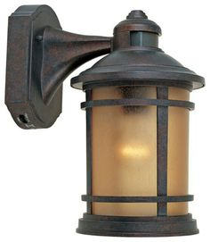 A Handsome Mediterranean Patina Finish Gives A Timeless Appeal To This Motion  Sensor, Dusk To Dawn Outdoor Light. High X Wide X Extends 9 From The Wall.
