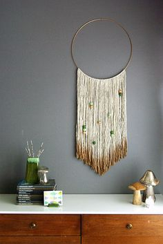 The same idea can be used on an embroidery hoop, too. | 28 Super Easy Yarn DIYs That Require Zero Knitting