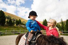 Ein Highlight für die Urlauberkinder sind die Ausritte mit den hauseigenen Ponys. Auf dem Rücken der Pferde können sich die Kleinen ganz groß fühlen. Das Hotel, Riding Helmets, Pony Rides, Brass Band Music, Petting Zoo, Vacation