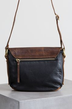 The rich contrast of two-tone leathers makes the Phoebe Leather Crossbody Handbag an exceptional design. Free shipping returns.