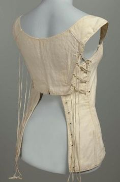 Corset. Possibly French, worn in America, early 19th century. Cotton, linen, baleen - in the Museum of Fine Arts Boston costume collection. (Very interesting back and side lacing on this one. Front view also available.)