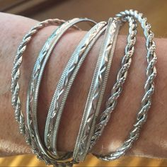 6 Bracelets  silver color all 6 locked together Six Shiny Silver Colored Bracelets. Six of them all bracelets locked together by one bracelet. .Easy to take on and off. Great as a gift to yourself or someone else. Jewelry Bracelets