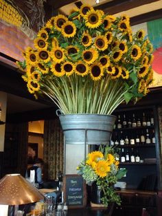 """My favorite flower in a 'OH-My-GAWD"""" arrangement at the Gramercy Tavern (it appeared in the GT's Facebook Fan Page).  #GramercyTavern #sunflowers"""