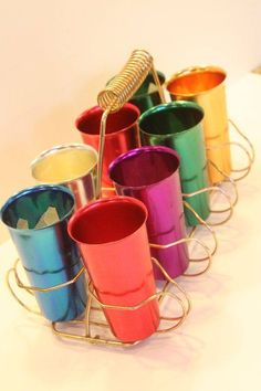 1950\'s Anodized Aluminum Tumblers in Holder. It seemed like everybody had these.  Grandma did!