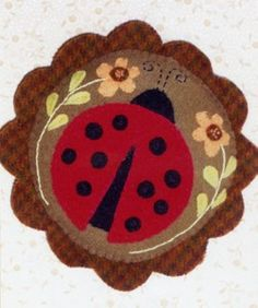 Lady Bug's Garden Pincushion $8.00  Would be nice on a penny rug