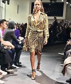 #NYFW Draped slit plunging neck and silk gold lamé #MichaelKors juxtaposes the soft sexiness with 70s glamour. #纽约时装周 Michael Kors用开衩垂坠超低胸与金丝绸纱让柔美性感与70年代华丽感完美结合  via VOGUE CHINA MAGAZINE OFFICIAL INSTAGRAM - Fashion Campaigns  Haute Couture  Advertising  Editorial Photography  Magazine Cover Designs  Supermodels  Runway Models