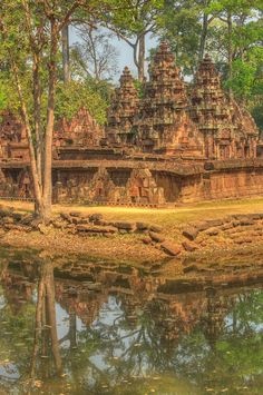 Temple reflection of Banteay Srei, a 10th-century magical #temple dedicated to the Hindu god Shiva - area of #Angkor in #Cambodia - MagicMurals
