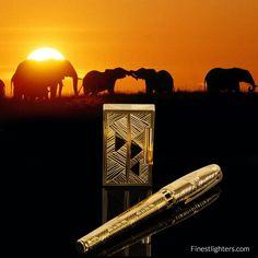 S.T. Dupont Afrika Limited Edition - 2001 - S.T. Dupont pays homage to African art with this astonishing Limited Edition, where different patterns of yellow gold, skilfully engraved by S.T. Dupont's craftsmen, makes a strong contrast with the dark inlaid onyx plates. The Limited Edition is made up of two pocket lighters numbered from 1 to 2000, a table lighter numbered from 1 to 100, a fountain pen and a ball pen each one numbered from 1 to 2000.