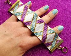 Peyote Bracelet Pattern in White, Teal, Purple & Gold - Ombre Ribbons - Flat Event Count Peyote for Miyuki Delicas SizeMy latest peyote bracelet pattern, Ombre Ribbons. A great beading project for beginner and intermediate beaders. Embroidery Floss Bracelets, Beaded Bracelet Patterns, Beading Patterns, Beaded Bracelets, Beading Tutorials, Peyote Beading, Crochet Bracelet, Silk Ribbon Embroidery, Loom Beading