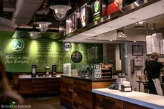 The interior is slick and modern, and it has the ubiquitous fast-casual combo of warm wood and sleek-brushed steel. The look is almost dated at this point, given how many Chipotle and Shake Shack clones have followed suit. Green is the dominant color at Wahlburgers, however.