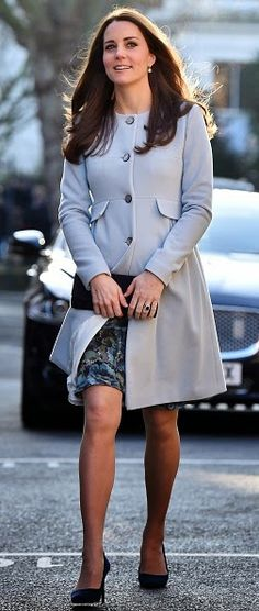 Catherie, Duchess of Cambridge wore a coat by maternity brand Seraphine and teamed it with a green and blue floral dress by the same label
