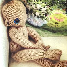 Ravelry: knitted baby and nappy - written as FLAT knitting pattern by Claire Garland