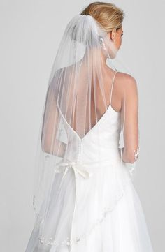 Beautiful veil with an embroidered border.