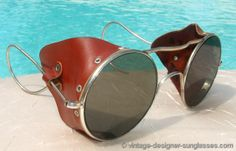 Rare and authentic vintage 1940s metal framed, leather blinkered pilot or motorcycle steampunk goggles look great as regular sunglasses, ski and snowboard glasses, or ready for the Harley or Cessna.