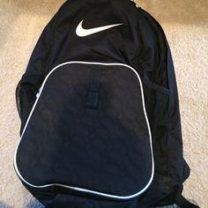 Nike Backpack Nike backpack, black and white. NWOT used once for a job. 4 pockets and super useful! Nike Bags Backpacks