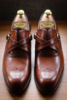 Barker Black - Brown loafers w/ cross leather detail.