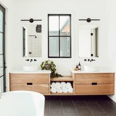 Cozy Modern Warm Bathroom Interior Design Ideas, modern bathroom with floating wood vanity and modern bathroom sconce