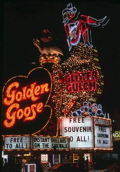 Golden Goose & Glitter Gulch. Las Vegas c.1990. The following year the owner turned the two casinos into a strip club but the casino's signs have remained ever since