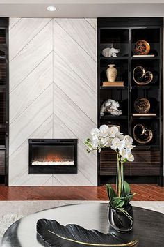 If you are looking to give your room a focal point or something to highlight it, look no further than the fireplace mantel that's already there. Many tend to leave their fireplace mantels bar… Fireplace Tv Wall, Fireplace Remodel, Fireplace Inserts, Fireplace Surrounds, Fireplace Ideas, Paint Fireplace Tile, Herringbone Fireplace, Fireplace Feature Wall, Fireplace Makeovers
