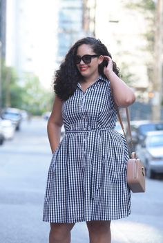 Tanesha Awasthi (a plus size Girl With Curves) wearing a gingham print shirtdress in downtown Vancouver.